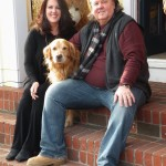 Leslie and Greg Gauthier, with the store's mascot Baxter at Village Toy Shoppe in New Hope
