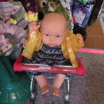 Old fashioned dolls and doll outfits at Village Toy Shoppe in New Hope